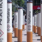 People walk past near an anti-tobacco installation in Montevideo